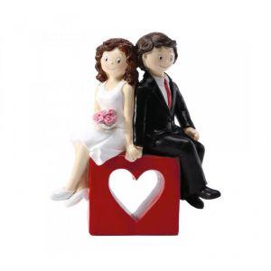 Figurine couple de mariés sur coeur rouge