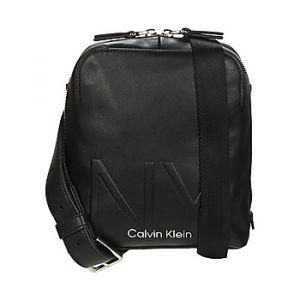 Calvin Klein Sacoche Jeans SHAPED CVRTBL MINI REPORTER Noir - Taille Unique