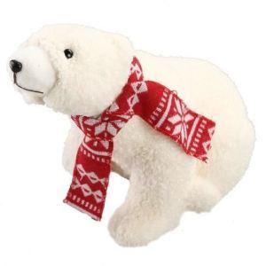 Ours assis avec écharpe tricotée rouge