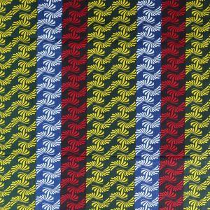 Craftine Tissu Wax Africain N°308 Courbes Vertes, rouges et bleues sur fond Vert sapin