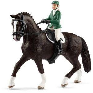 Schleich 42358 - Cavalière de saut d'obstacles avec cheval