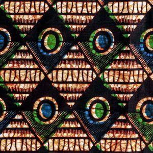 Craftine Tissu Wax Africain N°269 Triangles Verts et bleus sur fond Noir - Par 50 cm